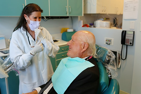 Our Midtown New York Dentist speaking with a patient