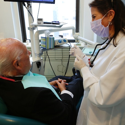 Image of Dr. Kantor-Goldenberg with a patient who is going to have a root canal using the latest technology.