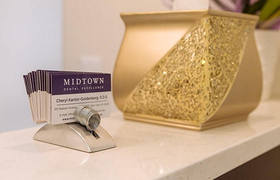 Photo of the front desk and business cards of Midtown Dental Excellence, a midtown cosmetic dentist office.