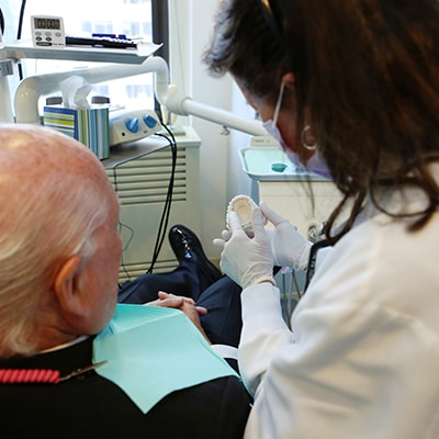 Image of one of our Midtown cosmetic dentists explaining a dental procedure to a patient