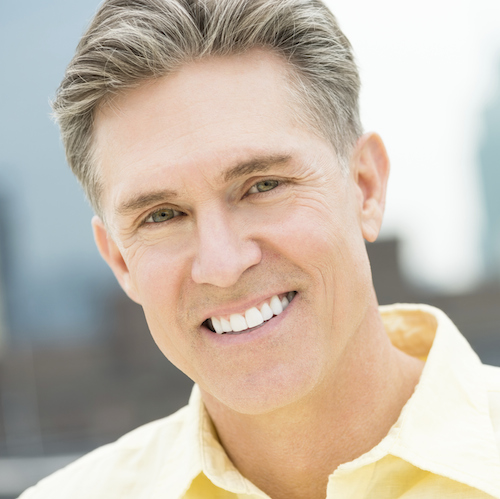 Midtown Manhattan Dental Services - Image showing a smiling man to showcase dental implants at Midtown Dental Excellence.