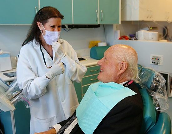 Our Midtown Manhattan dentist talking to a patient about metal-free fillings