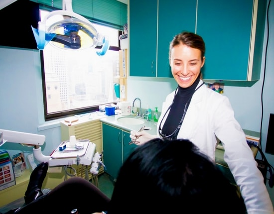 Our Midtown Manhattan dental office team member talking to a patient about dental crowns