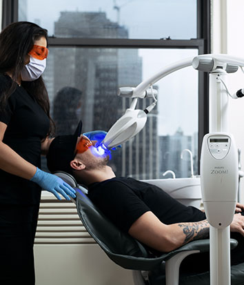 An actual patient receiving Zoom! Teeth Whitening at Midtown Dental Excellence